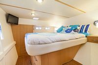 Master suite island bed on starboard.
